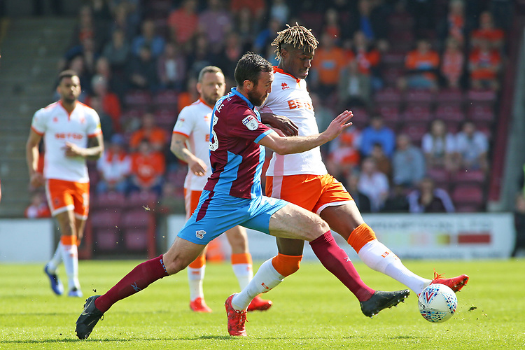 Blackpool's Armand Gnanduillet battles with Scunthorpe United's Rory McArdle<br /> <br /> Photographer David Shipman/CameraSport<br /> <br /> The EFL Sky Bet League One - Scunthorpe United v Blackpool - Friday 19th April 2019 - Glanford Park - Scunthorpe<br /> <br /> World Copyright © 2019 CameraSport. All rights reserved. 43 Linden Ave. Countesthorpe. Leicester. England. LE8 5PG - Tel: +44 (0) 116 277 4147 - admin@camerasport.com - www.camerasport.com
