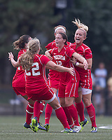 Boston University midfielder Jessica Luscinski (12) celebrates her goal with teammates. After 2 complete overtime periods, Boston College tied Boston University, 1-1, after 2 overtime periods at Newton Soccer Field, August 19, 2011.