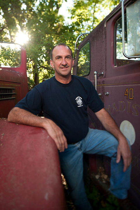On Aug. 21, 2011, Joe Conway, Jr., a lieutenant with the Madison Fire Department and union advocate, stands amid his collection of vintage fire trucks and engines stored in an overgrown lot behind his father's tavern, Joe's Fire House, in Monona, Wis. Conway is president of the International Association of Fire Fighters (IAFF) Local 311. (Photo by Jeff Miller for Governing Magazine)