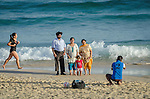 An Indian family poses for a photograph on Bondi Beach in Sydney, Australia