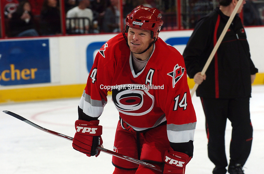 Carolina Hurricanes' Kevyn Adams grimaces after taking a hit during a game with the Florida Panthers Friday, March 3, 2006 at the RBC Center in Raleigh, NC. Carolina won 5-2.