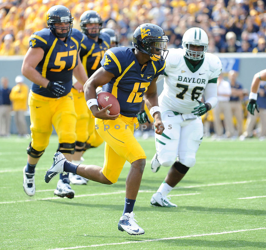 West Virginia Mountaineers Geno Smith (12) in action during a game against the Baylor Bears on September 29, 2012 at Milan Puskar Stadium in Morgantown, WV. West Virginia beat Baylor 70-63.