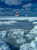 St Joseph Pier lighthouse near Benton Harbor, Michigan, on Lake Michigan after a winter storm.