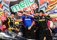 Sept. 1, 2014; Clermont, IN, USA; NHRA top fuel dragster driver Richie Crampton gets a champagne bath from crew chief Aaron Brooks while celebrating after winning the US Nationals at Lucas Oil Raceway. Mandatory Credit: Mark J. Rebilas-USA TODAY Sports
