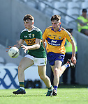 Dan McCarthy of Kerry in action against John Murphy of Clare during their Munster Minor football final at Pairc Ui Chaoimh. Photograph by John Kelly.