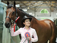 "4/8/2010. Rider Amy Fitzgerald is pictured in the stables of the Failte Ireland RDS Horse Show with Corileas Imp 1st place winner Large Riding Horse and 1st in Championship ""Champion"" owned by Michaela Butler from Straffan Co Kildare. Picture James Horan/Collins Photos"