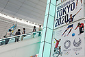 Travellers walk past a Tokyo Olympic and Paralympic Games advertisement on display at Tokyo International Airport on August 30, 2016, Tokyo, Japan. Between August 24 and October 10 the airport is displaying many Welcome to Tokyo 2020 signs to promote the 2020 Summer Olympic Games. (Photo by Rodrigo Reyes Marin/AFLO)