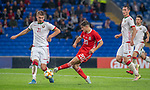 Cardiff - UK - 9th September :<br />Wales v Belarus Friendly match at Cardiff City Stadium.<br />Daniel James of Wales stikes the ball past Zakhar Volkov of Belarus.<br />Editorial use only