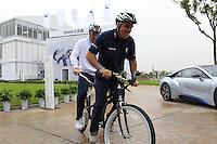 Paul McGinley (IRL) and Justin Rose (ENG) take to the tandem bike for the BMW i8 challenge during Wednesday's Pro-Am Day of the 2014 BMW Masters held at Lake Malaren, Shanghai, China 29th October 2014.<br /> Picture: Eoin Clarke www.golffile.ie