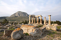 CORINTH, GREECE - APRIL 16 : A general view of the Temple of Apollo, on April 16, 2007 in Corinth, Greece. Standing prominently on a knoll the Temple of Apollo was built in the 7th century BC in the Doric Order. Seven of its original 38 columns remain standing and are seen here in the early morning light with the mountains in the background. It is one of the oldest temples in Greece. Corinth, founded in Neolithic times, was a major Ancient Greek city, until it was razed by the Romans in 146 BC. Rebuilt a century later it was destroyed by an earthquake in Byzantine times. (Photo by Manuel Cohen)