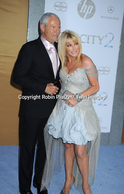 "Alan Hamel and wife Suzanne Somers  posing for photographers at the world premiere of ""Sex and the City 2"" on May 24, 2010 at Radio City Music Hall in New York City."
