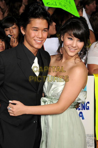"BOO BOO STEWART & GUEST.""Twilight: New Moon"" Los Angeles Premiere held at Mann's Village Theatre, Westwood, California, USA..November 16th, 2009.half length black suit jacket  green grey gray strapless dress arms around waist .CAP/ADM/BP.©Byron Purvis/AdMedia/Capital Pictures."