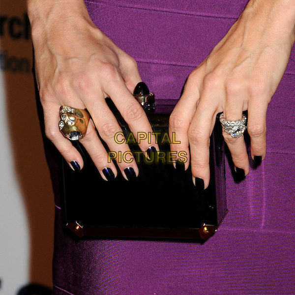 ANGIE HARMON'S BAG.EIF's Women's Cancer Research Fund Benefit held at the Beverly Wilshire Hotel, Beverly Hills, California, USA..January 27th, 2010.hands purple black rings nail varnish polish metallic purple blue gold diamonds .CAP/ADM/BP.©Byron Purvis/AdMedia/Capital Pictures.