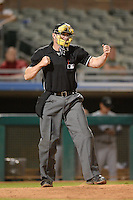 Home plate umpire Marcus Pattillo during an Arizona Fall League game between the Mesa Solar Sox and Peoria Javelinas on October 17, 2013 at HoHoKam Park in Mesa, Arizona.  Mesa defeated Peoria 6-1.  (Mike Janes/Four Seam Images)