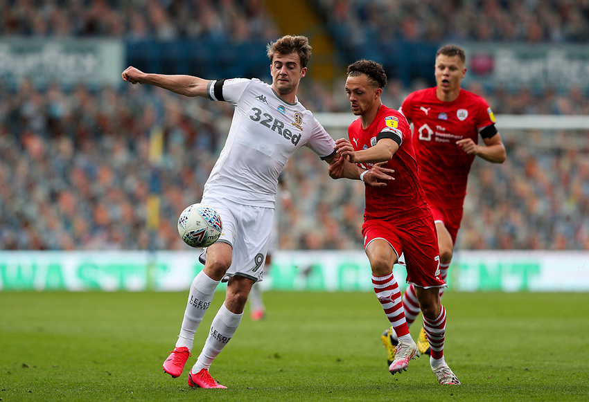 Leeds United's Patrick Bamford vies for possession with Barnsley's Jordan Williams<br /> <br /> Photographer Alex Dodd/CameraSport<br /> <br /> The EFL Sky Bet Championship - Leeds United v Barnsley - Thursday 16th July 2020 - Elland Road - Leeds<br /> <br /> World Copyright © 2020 CameraSport. All rights reserved. 43 Linden Ave. Countesthorpe. Leicester. England. LE8 5PG - Tel: +44 (0) 116 277 4147 - admin@camerasport.com - www.camerasport.com