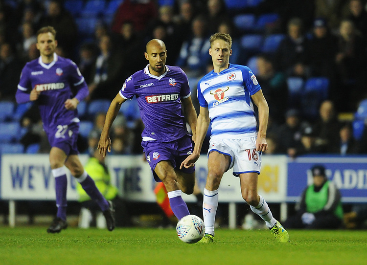 Reading's Dave Edwards under pressure from Bolton Wanderers' Karl Henry<br /> <br /> Photographer Kevin Barnes/CameraSport<br /> <br /> The EFL Sky Bet Championship - Reading v Bolton Wanderers - Tuesday 6th March 2018 - Madejski Stadium - Reading<br /> <br /> World Copyright &copy; 2018 CameraSport. All rights reserved. 43 Linden Ave. Countesthorpe. Leicester. England. LE8 5PG - Tel: +44 (0) 116 277 4147 - admin@camerasport.com - www.camerasport.com