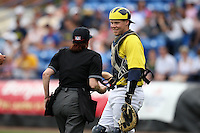 March 21, 2010:  Catcher Chris Berset (10) of the Michigan Wolverines in the field joking with the home plate umpire during a game at Tradition Field in St. Lucie, FL.  Photo By Mike Janes/Four Seam Images
