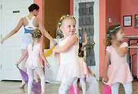 "NWA Democrat-Gazette/CHARLIE KAIJO Emmy Cloud, 4, (center) watches herself in a mirror as she dances during a ballet summer mini-camp, Monday, July 8, 2019 at Radiance Ballet studio in Centerton. <br /> <br /> The studio is holding a three day summer mini-camp this week for three and four year olds. The class introduces youth to the foundations of ballet, and for many students, it's their first time. The class teaches them how their body's move and ways to use their imagination.<br /> <br /> ""[Ballet is] great for sensory input, coordination, balance and focus,"" said Tara Klamm, the studio's director. ""A lot of them it's the first time they've been in a structured class environment."""