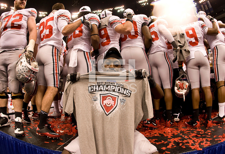 Orhian Johnson of Ohio State holds up 2011 Sugar Bowl Champion shirt during the celebration moment after winning the game against Arkansas during 77th Annual Allstate Sugar Bowl Classic at Louisiana Superdome in New Orleans, Louisiana on January 4th, 2011.  Ohio State defeated Arkansas, 31-26.
