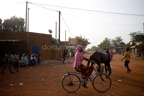 Near the racecourse, horses make go back and forth to relax their legs because of the heat of June which strikes Burkina.