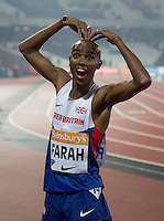 Mo Farah of GBR (Men's 3000m) celebrates his victory during the Sainsburys Anniversary Games at the Olympic Park, London, England on 24 July 2015. Photo by Andy Rowland.