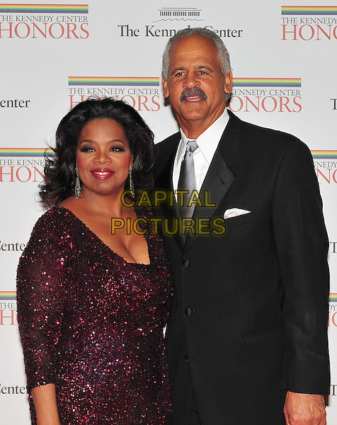 Oprah Winfrey and Stedman Graham.The formal Artist's Dinner at the United States Department of State in Washington, D.C., USA..December 4th, 2010.half length black suit red purple dress sparkly moustache mustache facial hair couple .CAP/ADM/RS.©Ron Sachs/CNP/AdMedia/Capital Pictures.