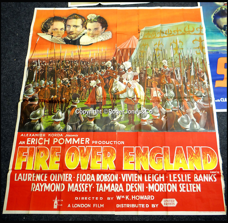 BNPS.co.uk (01202 558833)<br /> Pic: RogerJones&Co/BNPS<br /> <br /> 1937 film poster for Fire Over England starring Vivien Leigh and Laurence Olivier.<br /> <br /> A rare collection of 1930s and 40s cinema posters discovered by two builders after they were used as carpet underlay have sold for a whopping £75,000.<br /> <br /> More than half the total was made on a single poster, John Wayne's breakthrough film Stagecoach (1939), which sold for £31,000.<br /> <br /> The classic Hollywood movie posters, which were in near pristine condition, are from the halcyon days of cinema and included well known names such as Alfred Hitchcock, Sir Laurence Olivie and Boris Karloff.<br /> <br /> Before the sale auctioneers Rogers Jones & Co said it was difficult to predict what the posters would sell for as no comparisons had ever come to market but the collection of about 120 posters was expected to fetch several thousands.<br /> <br /> Two builders made the discovery in 1985 when they were renovating the home of a local cinema owner who had died in Penarth, south Wales.