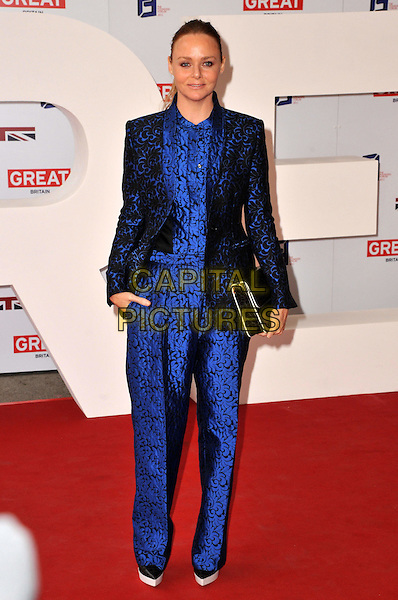 Stella McCartney.UK's Creative Industries Reception celebrating people in the UK culture, arts and entertainment industries, supported by the Founders Forum. Royal Academy of Arts, Piccadilly, London, England..30th July 2012.full length blazer jumpsuit black blue print clutch bag.CAP/BF.©Bob Fidgeon/Capital Pictures.