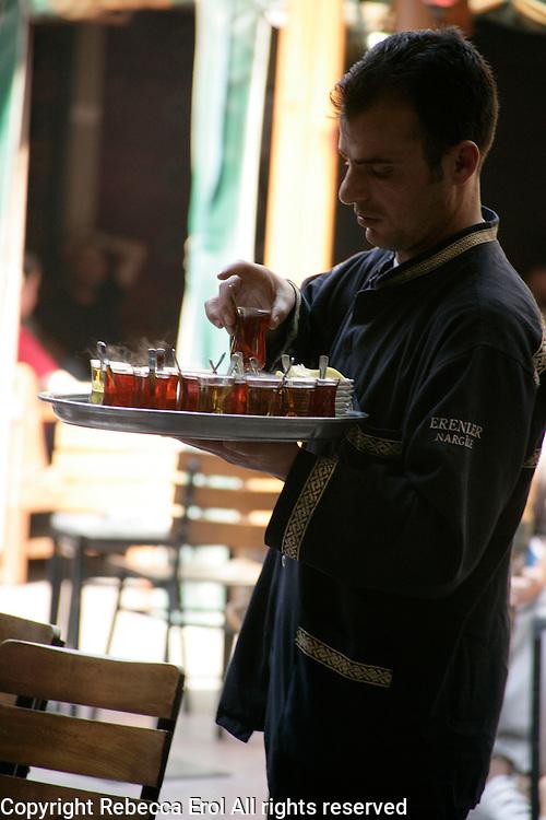 Serving Turkish tea in the Ali Corlulu Pasha Medresesi close to the Grand Bazaar, Turkey