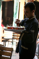 Serving Turkish tea in the Ali Corlulu Pasha Medresesi close to the Grand Bazaar, Turkey