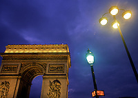 Arc de Triomphe and stretlights at night. Paris, France.