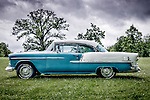 American 1950's Bel Air Chevrolet classic car in blue and white outdoors parked on grass