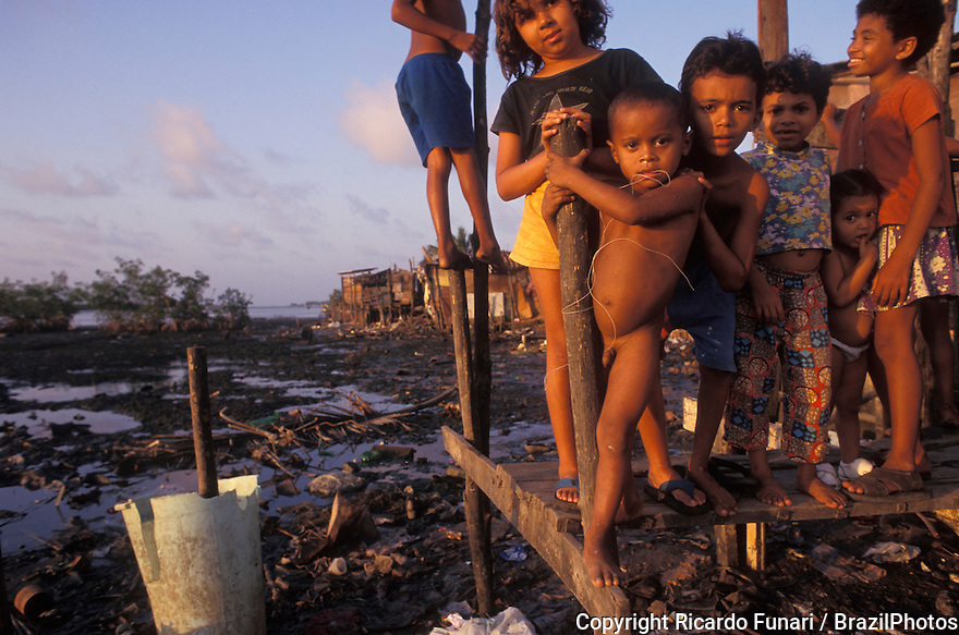 Children in poverty, lack of wastewater treatment services and sanitation in Brazilian favela -  stilt houses. Natal city, Rio Grande do Norte State, Northeastern Brazil.