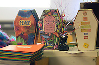 Some of the funeral casket boxes that Kyle Tevlin uses as props are seen at her fun funeral planning class Wednesday, October 19, 2016 at Keith Valley Middle School in Horsham, Pennsylvania. Devlin runs a Devon-based, personal-planning business that finds creative ways to hold funerals and memorials at places that meant something to the deceased, whether that's a beach or a bar. (WILLIAM THOMAS CAIN / For The Philadelphia Inquirer)
