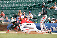 First baseman Matt Olson #17 of Parkview High School in Lilburn, Georgia takes a throw trying to double up Ryan Ripken #20 sliding back to first on a line drive as Christian Dicks #11 looks on during the Under Armour All-American Game at Wrigley Field on August 13, 2011 in Chicago, Illinois.  Ripken was called safe on the play.  (Mike Janes/Four Seam Images)