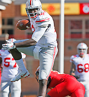 Ohio State Buckeyes quarterback Cardale Jones (12) leaps over the Maryland defense in the fourth quarter of their game at Byrd Stadium in College Park, Maryland on October 4, 2014. (Columbus Dispatch photo by Brooke LaValley)