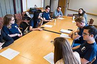 """Resistance School logistics group volunteers meet before a session of Resistance School in the Taubman Building of Harvard University's John F. Kennedy School of Government, on Thurs., April 27, 2017. The goal of the meeting was to plan how to direct attendees from the registration location to the lecture location. Resistance School was started by progressive graduate students at Harvard after the Nov. 8, 2016, election of President Donald Trump. Resistance School describes itself as a """"practical training program that will sharpen the tools [needed] to fight back at the federal, state, and local levels."""" Resistance School puts on live lectures by leading progressives that are streamed and archived online alongside other information on the Resistance School website. During the lectures, teams of volunteers engage with followers on social media, including Facebook and twitter, sharing soundbytes, quotations, and supplementary materials as the lectures happen."""