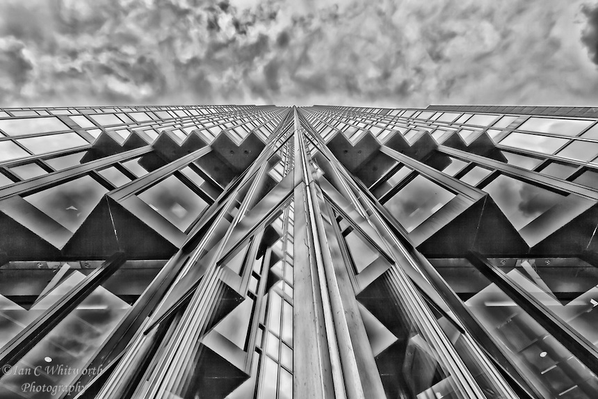 A black and white abstract architectural view looking up the face of the royal bank tower