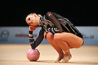 Caroline Weber of Austria begins routine with ball during event finals at World Cup Montreal on January 30, 2011.  (Photo by Tom Theobald).