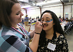 Noemi Ortiz gets her face painted by nursing student Nicole Williams during the annual Western Nevada College Foundation Scholarship Appreciation &amp; Recognition Celebration in Carson City, Nev., on Friday, March 9, 2018. More than $260,000 in scholarships were awarded to more than 100 WNC students.<br /> Photo by Cathleen Allison/Nevada Momentum