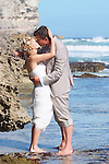 A couple in love sealed with a kiss on the best beach on Kangaroo Island South Australia at Pennington Bay one of the most amazing weddings.
