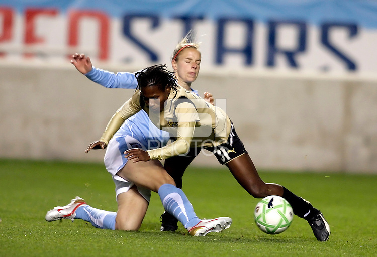 Chicago Red Star midfielder Lindsay Tarpley (5) fouls FC Pride midfielder Formiga (31).  The defeated the FC Gold Pride defeated the Chicago Red Stars 1-0 at Toyota Park in Bridgeview, IL on May 16, 2009.