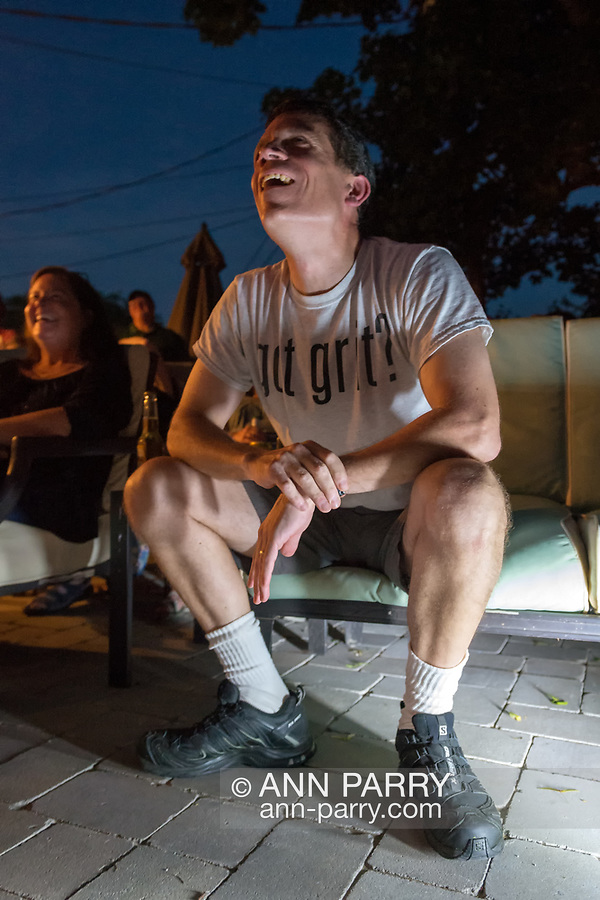 """Merrick, New York, USA. 11th June 2017.  CHRIS EDOM, """"American Grit"""" TV series contestant, 48, of Merrick, wears GOT GRIT? T-shirt as he sits in his backyard with family, friends, neighbors, at his Viewing Party for Season 2 premiere of the FOX network reality television series."""