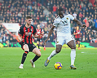 Chris Mepham of AFC Bournemouth left challenges Willy Boly of Wolverhampton Wanderers during AFC Bournemouth vs Wolverhampton Wanderers, Premier League Football at the Vitality Stadium on 23rd February 2019