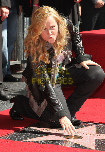 Melissa Etheridge.Melissa Etheridge Honored with a star on the Hollywood Walk of Fame  Held at On Hollywood Blvd., Hollywood, California, USA..27 September 2011 .full length black jacket jeans denim leather studs studded hand touching kneeling funny .CAP/ADM/KB.©Kevan Brooks/AdMedia/Capital Pictures.