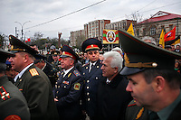 Two officers wearing the uniform of the Ministry of State Security (the Transnistrian KGB) stand in the middle of a crowd of military officers taking part in a ceremony marking the 65th anniversary of the liberation of Tiraspol from Nazi occupation by the Soviet Army in Tiraspol, Transnistria on 12 April 2009.