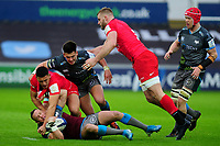 Hanno Dirksen of Ospreys is tackled by Manu Vunipola of Saracens during the Heineken Champions Cup Round 5 match between the Ospreys and Saracens at the Liberty Stadium in Swansea, Wales, UK. Saturday January 11 2020.