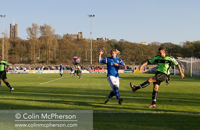 Action from the first half as Lancaster City play against FC Halifax Town in an FA Cup third qualifying round match at Giant Axe stadium, with Lancaster Castle visible in the background. The visitors, who play two leagues above their hosts in the English football pyramid, won the ties by three goals to nil, watched by a crowd of 646 spectators. Lancaster City were celebrating their centenary in 2011, although there was a dispute over the exact founding date over the club known as Dolly Blue.
