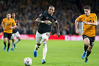 4th January 2020; Molineux Stadium, Wolverhampton, West Midlands, England; English FA Cup Football, Wolverhampton Wanderers versus Manchester United; Ashley Young of Manchester United chasing a loose ball followed by Ruben Vinagre of Wolverhampton Wanderers  - Strictly Editorial Use Only. No use with unauthorized audio, video, data, fixture lists, club/league logos or 'live' services. Online in-match use limited to 120 images, no video emulation. No use in betting, games or single club/league/player publications
