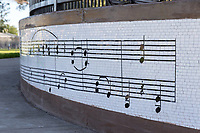 A closeup image showing the musical-score themed mosaic around the bandstand at South Gate Park.
